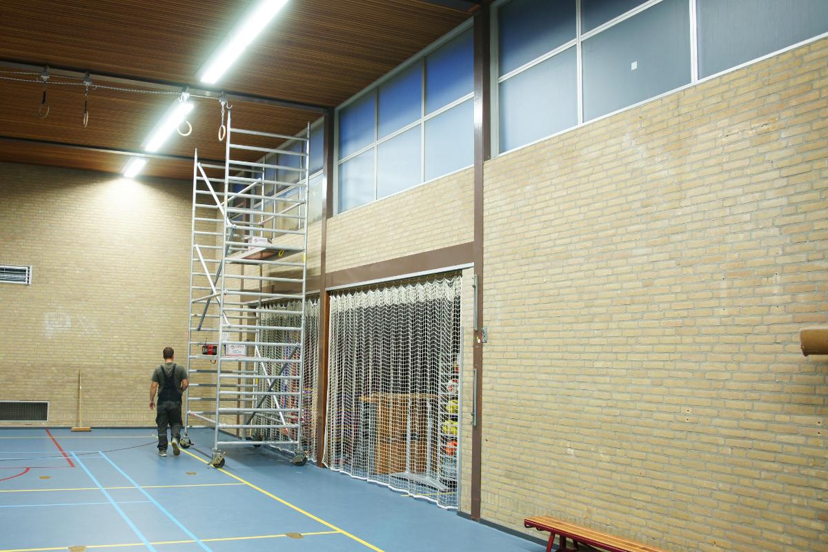 Kitwerk aluminium raamkozijnen gymzaal in Tilburg